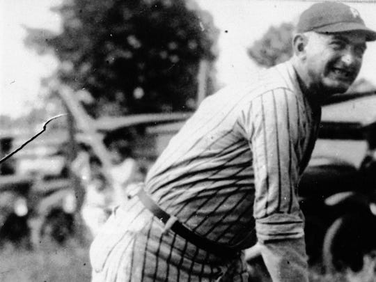 """""""Shoeless"""" Joe Jackson is shown in action during his heyday in this undated photo."""