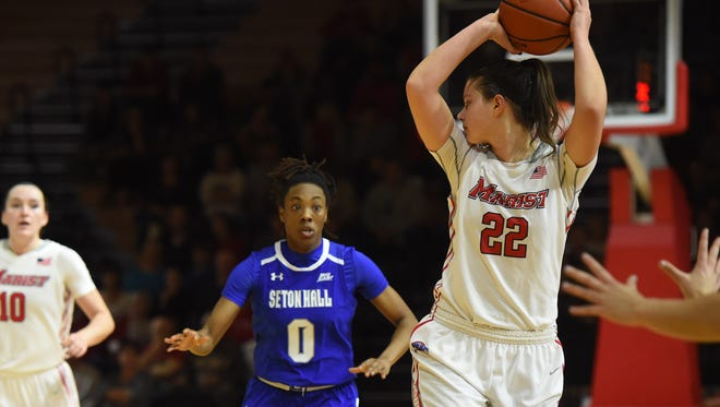 Morgan Bartner handles the ball in front of Maura Fitzpatrick in the Marist women's basketball team's home opener against Seton Hall on Nov. 15.