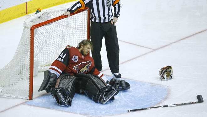 Arizona Coyotes goalie Mike Smith (41) sits on the ice after colliding with Anaheim Ducks right wing Jakob Silfverberg (33) during the third period of their NHL game Monday, Feb. 20, 2017 in Glendale, Ariz.