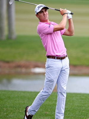 Feb 28, 2016; Palm Beach Gardens, FL, USA; Justin Thomas plays from the rough on the first hole during the final round of the Honda Classic at PGA National. Mandatory Credit: Peter Casey-USA TODAY Sports