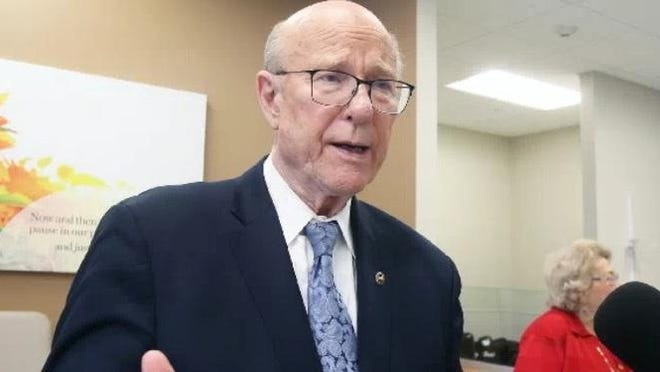 Sen. Pat Roberts talks to reporters in February 2018.