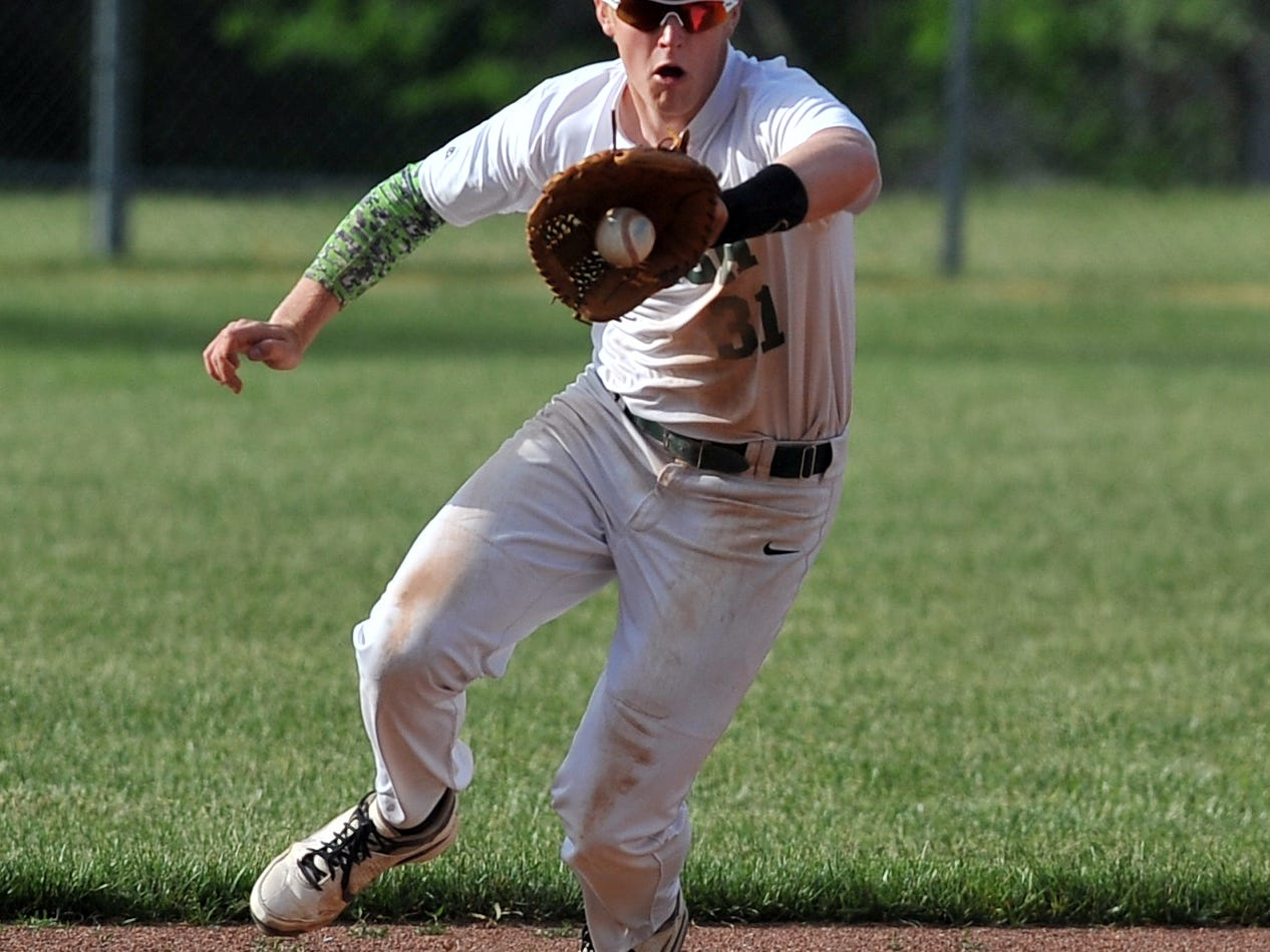 Fisher Catholic second baseman Blake Saffell fields a ground ball Wednesday in Lancaster. The Irish won the game against Fairbanks 5-2.