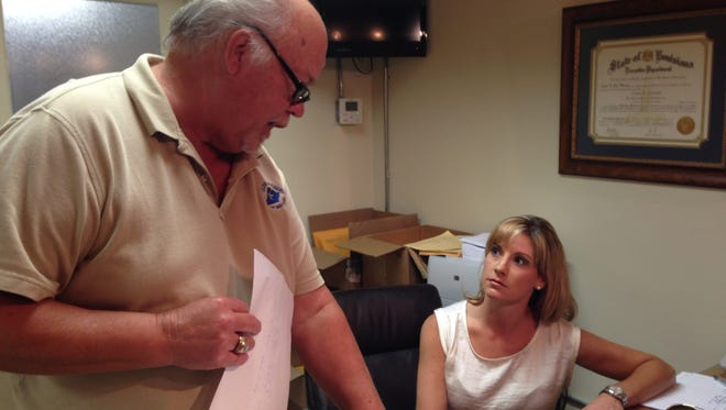 Andrea Ducote Aymond talks with James Baronne of the Avoyelles Parish Clerk of Court's Office on Thursday as she qualifies to run for a judgeship in the 12th Judicial District in Avoyelles Parish. She is believed to be the first female to ever run for a 12th District judgeship.