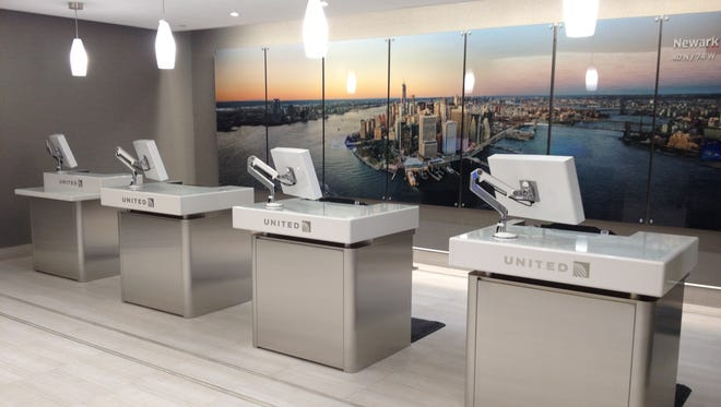 Check-in podiums are seen at United's new Global Services check-in area at Newark Liberty International Airport.