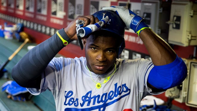 Yasiel Puig was smuggled into Mexico by members of a drug cartel who cut a deal with a Miami businessman.