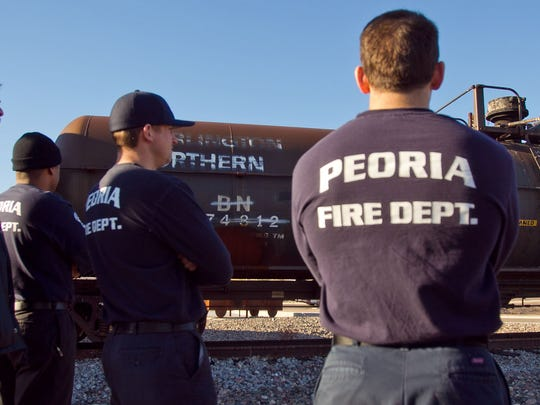 Peoria fire gather to discuss on how to put out a railroad tank car fire at Glendale Regional Public Safety Training Center. A committee of residents has suggested a proposed sales-tax increase be used to purchase smaller Fire Department vehicles to respond to medical emergencies.