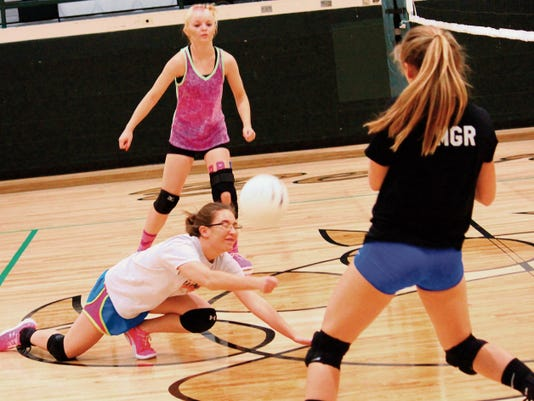 Jordyn Dempsey dives for a ball during practice Tuesday afternoon at the Cloudcroft High School gym.