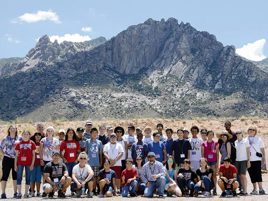 The GEMS Middle School group poses for a picture at the Small Arms Range after ending their first day of the weeklong program.