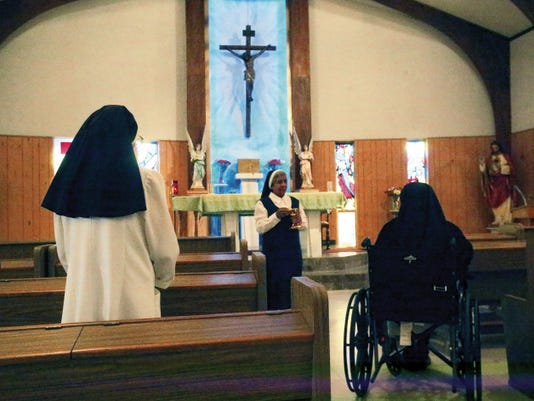 Sisters of Our Lady of the Charity at 415 N. Glenwood receive Communion in their chapel Friday. The convent, made up of six nuns, provide food to the needy. See more photos elpasotimes.com.