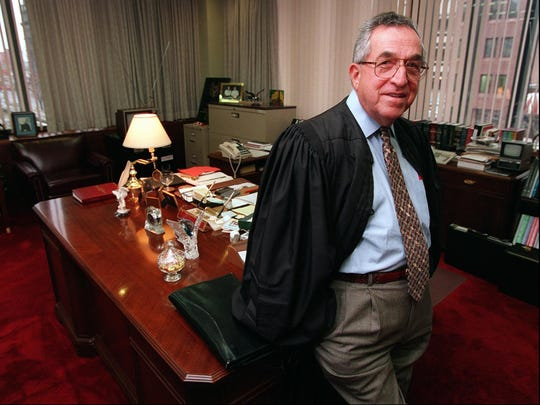 Judge Michael A. Telesca pictured here in his office in 1995.