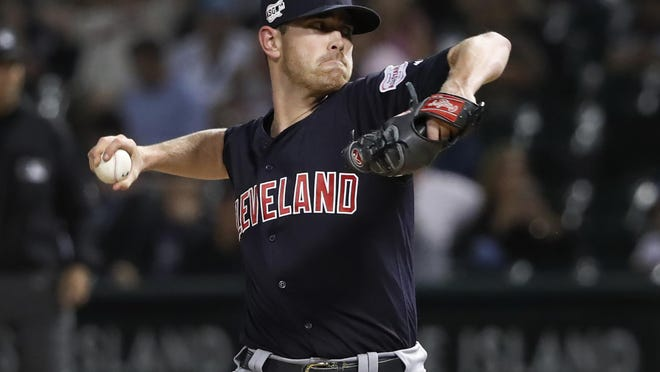 Cleveland Indians starting pitcher Shane Bieber delivers during the first inning of the team's baseball game against the Chicago White Sox on Wednesday, Sept. 25, 2019, in Chicago.