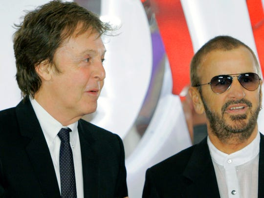 McCartney and Starr attend the first anniversary of