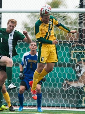 Vermont's Brad Cole (6) heads the ball during a game against Dartmouth earlier this season.