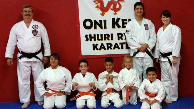 Five students earned their orange belts Wednesday at Oni Ken Shuri Ryu Karate in Silver City. Pictured are, from left, Sensei Trent Petty, students Anna Maynes, Reno Hughes, Aidan Camacho, Rowen Meurs, Cayden Flores, and Sensei Chad Petty, Sensei Chelsea Been.