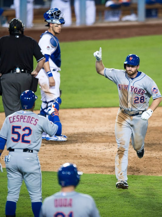 New York Mets' Daniel Murphy celebrates his solo home run against the Los Angeles Dodgers during the sixth inning of Game 5 of the National League Division Series, Thursday, Oct. 15, 2015, in Los Angeles. The Mets won 3-2. (Michael Goulding/The Orange County Register via AP)
