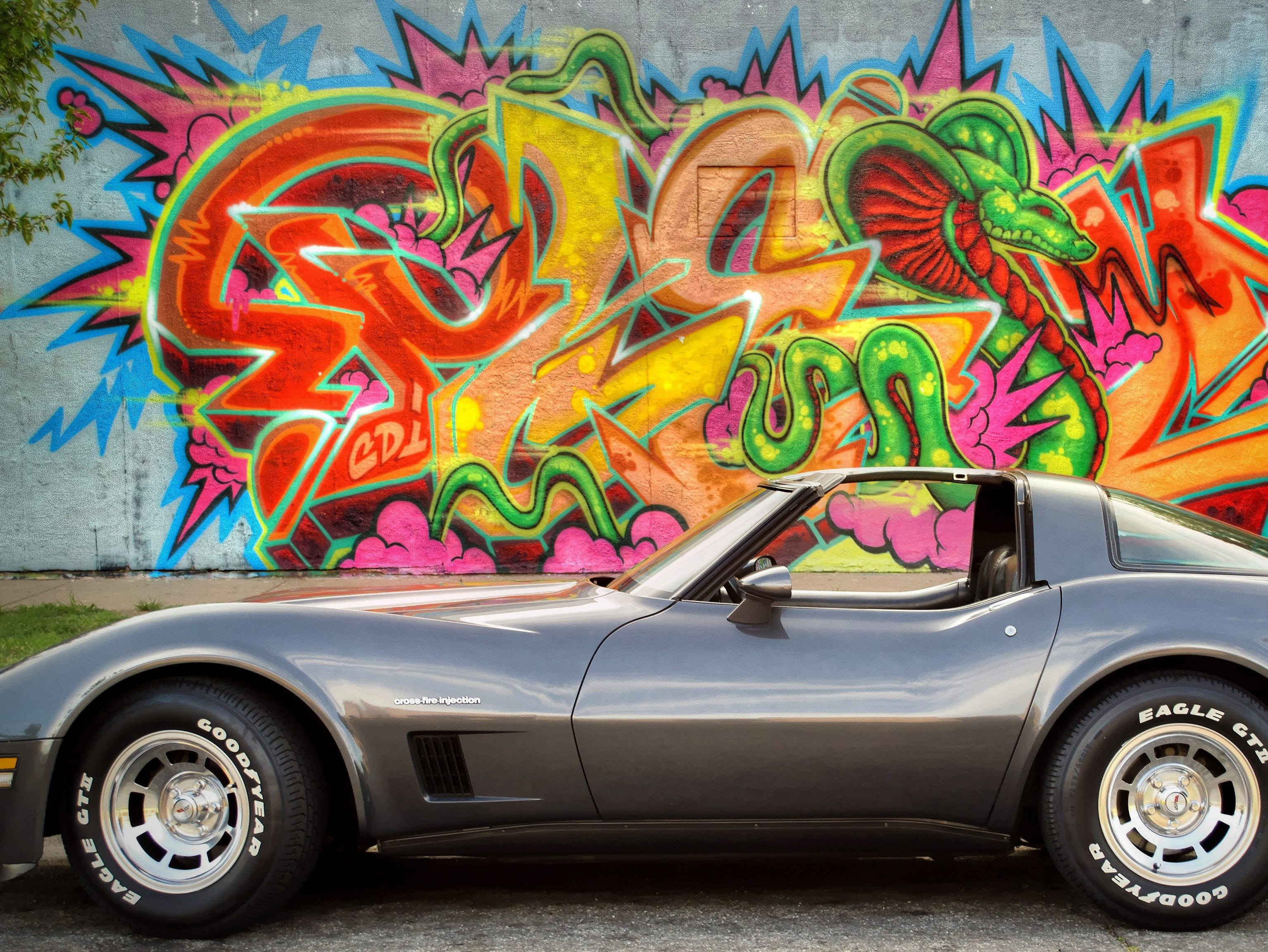 """We're honoring readers' """"Best of Corvettes"""" for the Chevy Corvette's 60th Anniversary and the debut of the iconic brand's latest 2014 model. Here is Brad Oliphant's1982 Chevy Corvette pictured outside of a tattoo parlor in Wichita, Kan."""