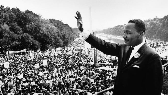 """Dr. Martin Luther King Jr. waves to the crowd at the March on Washington in Washington, D.C., on Wednesday, Aug. 28, 1963. The purpose of the march was to advocate for civil and economic rights for African-Americans. At the march, King , standing in front of the Lincoln Memorial, delivered his historic """"I Have a Dream"""" speech in which he called for an end to racism."""