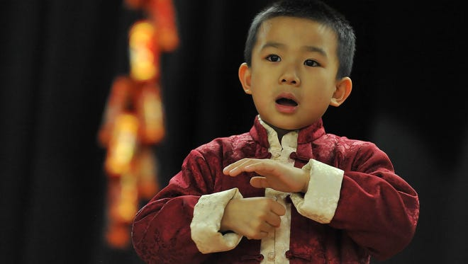 Nolan Prom, 5, a kindergarten student at the Chinese School of South Jersey, rehearses a song.