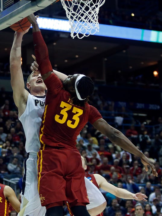 Iowa State's Solomon Young (33) blocks a shot by Purdue's Isaac Haas (44) during the first half of an NCAA college basketball tournament second-round game Saturday, March 18, 2017, in Milwaukee. (AP Photo/Kiichiro Sato)