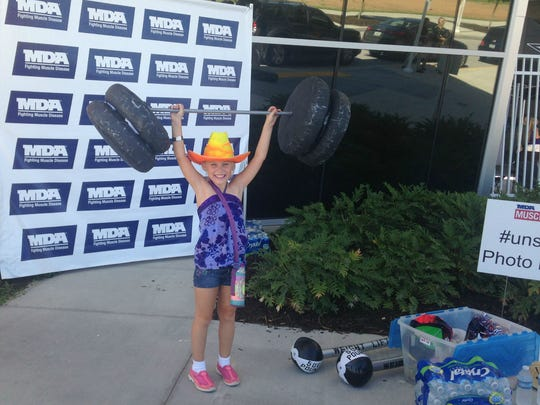 Seven-year-old Cristina Pomella poses as she shows