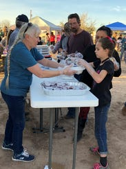 Volunteers put together free Thanksgiving meals for