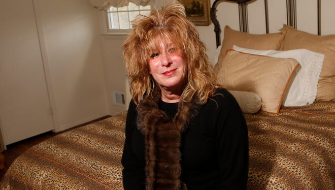 Susanne Nadell-Scaccio at the Valley Cottage home of her mother, Peggy Nadell, on Monday. Peggy Nadell was slain in her home last year. Scaccio used to stop by to wake up her mother in the morning sometimes.