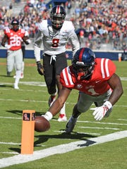 Ole Miss wide receiver A.J. Brown (1) dives into the end zone for a touchdown during the first half of an NCAA college football game against Louisiana-Lafayette in Oxford, Miss., Saturday, Nov. 11, 2017. (AP Photo/Thomas Graning)