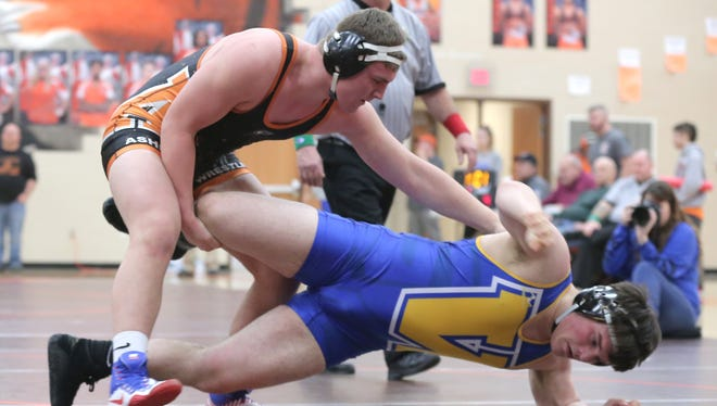 Junior 220-pounder Josh Bever became a three-time champ for threepeat champ Ashland in Saturday's Ohio Cardinal Conference wrestling tournament.