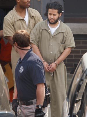 U.S. marshals lead Mufid A. Elfgeeh, a naturalized U.S. citizen from Yemen, out of federal court in Rochester following a hearing in June.
