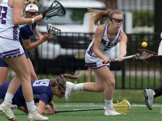 Rumson's Megan McGillis scoops up a loose ball during first half action. Rumson/Fair Haven girls lacrosse beat Manasquan for Shore Conference Tournament Title on May 12, 2018 at Monmouth University.