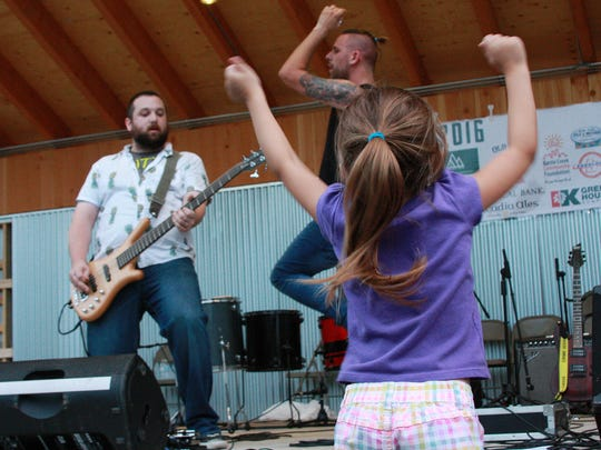 The New Day Revolution band plays for the crowd at Leilapalooza in 2015.