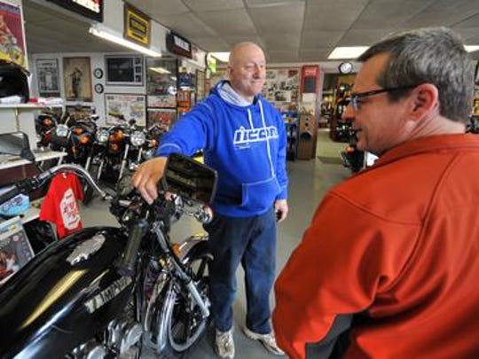 S-K Service owner Steve Kasten talks with customer Rick Cywinski of Mosinee in March. Kasten was in the midst of chemotherapy for bladder cancer at the time.