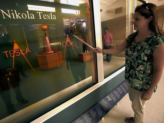 VICTOR CALZADA-EL PASO TIMES Mandy Kirchgessner demonstrates how the Tesla coil works Wednesday at the new Insights.