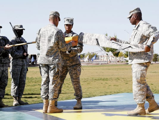MARK LAMBIE—EL PASO TIMES The 15th Sustainment Brigade reflagged as the 1st Armored Division Sustainment Brigade, then cased their colors for deployment to Afghanistan Thursday.