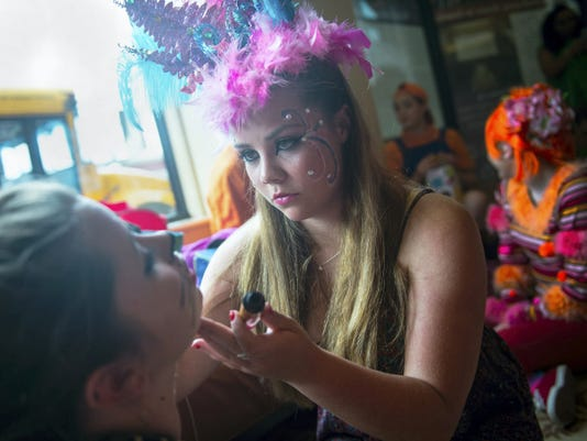 Bermudian Springs High School student Alexa Frey puts makeup on castmate Kaitlyn Livelsberger on May 17 at the Majestic Theater in Gettysburg.