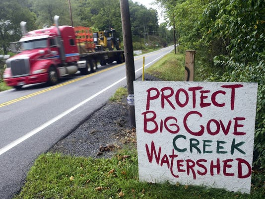 A sign along Great Cove Road, south of McConnellsburg on Thursday, September 11, 2014 read in opposition to a proposed hog farm in the area.