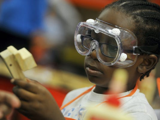 Byron Maddox Jr., of York, works on building an ambulance during a session designed to increase fire safety awareness. Home Depot will host another this Saturday.
