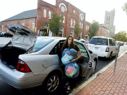 Makenzie Boyd donates coats to York Rescue Mission.
