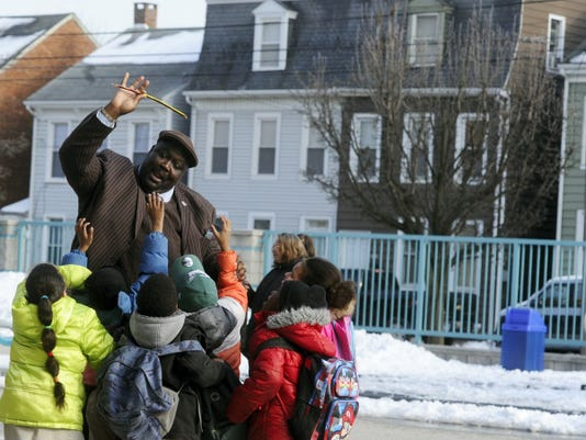 Leonard Hart, the principal at Lincoln Charter School, jokes around with a crowd of students in a game of keep away during dismissal at the York school on a February afternoon. Hart, who is seldom behind is desk, can commonly be seen helping out around the school, from serving meals to directing traffic. According to Anne Clark, community outreach coordinator of the school, 90 percent of the students who attend Lincoln live within an eight-block radius of the West King Street building.