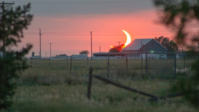 Sunset eclipse: A partial solar eclipse appears in the sky at sunset in Amarillo, Texas, in May 2012.