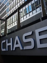 A former Metro Detroit bank branch manager for JP Morgan Chase was awarded more than $370,000 by an arbitrator over his termination.