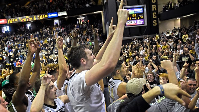 Vanderbilt forward Luke Kornet (3) leads his teammate and the crowd in cheers after defeating Florida 73-71 at Memorial Gym.Saturday March 4, 2017, in Nashville, TN