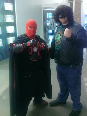 """Brian Crane adopted a superhero persona to promote efforts to help the homeless.  On Saturday his friend Brian Blackwood, AKA: """"Black Shamrock"""" joined his efforts."""