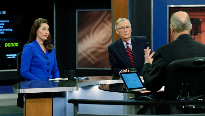 """U.S. Senate Minority Leader Mitch McConnell (R) Ky.,  center, and  Democratic opponent, Kentucky Secretary of State Alison Lundergan Grimes, rehearsed with host Bill Goodman before their appearance on """"Kentucky Tonight"""" television broadcast live from KET studios in Lexington, Ky., on Oct. 13, 2014. Photo by Pablo Alcala 
