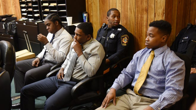 Jhymiere Moore, Jeffrey Ellerbee and Marshae Anthony, who are all defendants on trial for the shooting death of 12 year-old Genesis Rincon, are seen in the courtroom of Judge Scott Bennion in Passaic County Courthouse while the jury deliberates on Wednesday, Nov. 16, 2016.