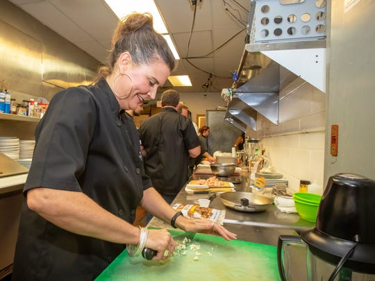Mary Ester Reed cuts onions at the annual Charity Chopped