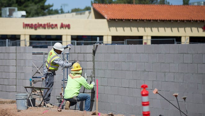 Construction crews build a Walgreens on the corner of 32nd street and Shea in Phoenix on April 23, 2015. Phoenix is focusing on revitalization of 32nd street corridor in between Shea and Union Hills.