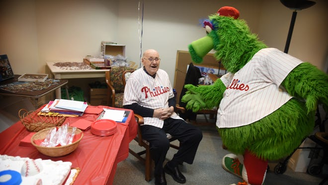 The Phillie Phanatic surprises Lester Shenk, of Myerstown, at Shenk's 100th birthday party on Saturday at StoneRidge Retirement Living in Myerstown. Shenk turned 100 on Jan. 7.