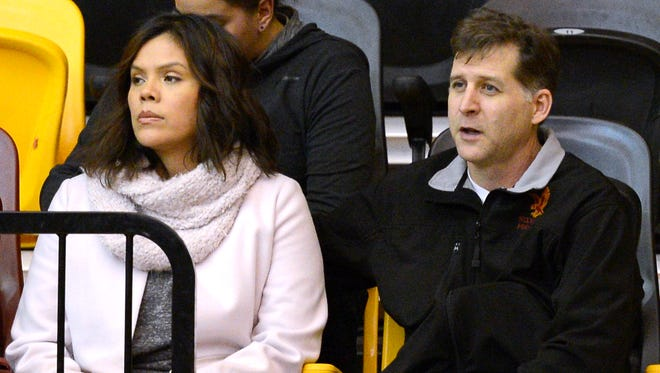 From left, Santa Fe Indian School's former head boys basketball coach Ceci Moses and her husband, Rick Schimmel, attend the school's boys basketball game Tuesday, Feb. 23, in the Pueblo Pavilion at Santa Fe Indian School in Santa Fe, New Mexico.