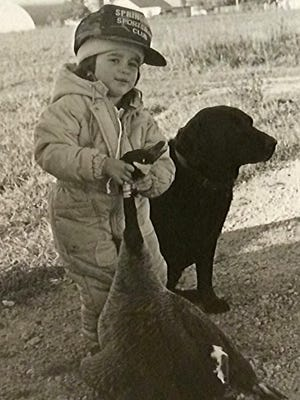 Patrick Durkin started taking his girls goose hunting when they were age 3. Here, Leah Durkin picks up a goose he shot in 1988.